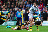 Matt Banahan of Bath Rugby offloads the ball after being tackled by Tom Wood of Northampton Saints. Aviva Premiership match, between Northampton Saints and Bath Rugby on September 3, 2016 at Franklin's Gardens in Northampton, England. Photo by: Patrick Khachfe / Onside Images