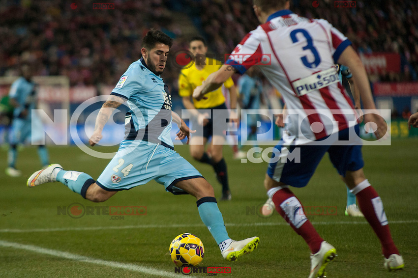 Atletico de Madrid&acute;s Guilherme Siqueira and Rayo Vallecano&acute;s Alejandro Pozuelo during 2014-15 La Liga match between Atletico de Madrid and Rayo Vallecano at Vicente Calderon stadium in Madrid, Spain. January 24, 2015. (ALTERPHOTOS/Luis Fernandez) /NortePhoto<br />