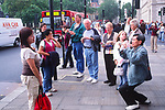 AWFP97 Tourists taking photos in London