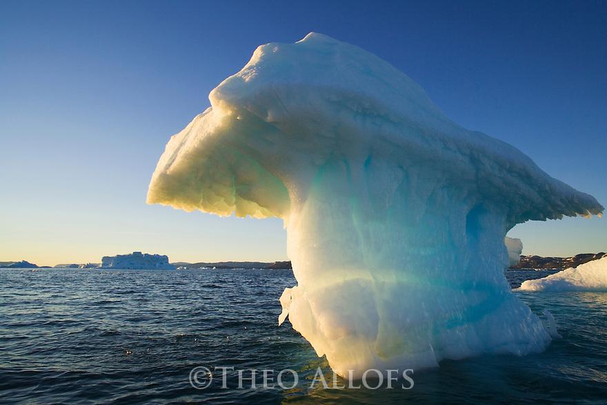 Small iceberg drifting in Disko Bay, midnight, end of June, mid summer night; Greenland