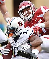 Arkansas Democrat-Gazette/BENJAMIN KRAIN --10/24/2015--<br /> Arkansas defensive lineman Tevin Beanum (97) tackles Auburn WR Stanton Truitt during the Razorbacks 4OT victory.