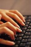 Teen girl typing on computer keyboard doing her homework Marysville Washington State USA
