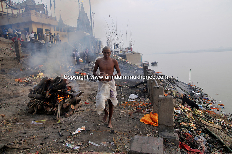 Manikarnika ghat in Varanasi is thought to be the most important burning ghats by the Hindus. A huge number of bodies are burnt hear and the leftovers after the funeral and unburnt body parts are thrown in the river. Varanasi, Uttar Pradesh, India.