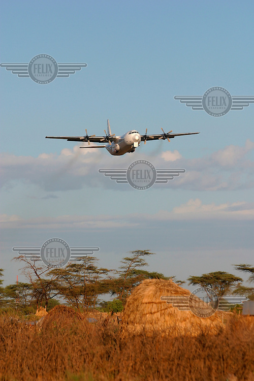 A C-130 Hercules transport plane takes off from Logichoggio airport. The plane, operated by the United Nations World Food Programme (UN WFP), is on its way into Southern Sudan to drop food aid. The civil war has displaced the civilian population and created constant food shortages.