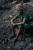 Sagar Kumar Ghuijan, a daily wage labourer poses for a portrait in Goladi coal depot in Jharia, outside of Dhanbad in Jharkhand, India.  Photo: Sanjit Das/Panos