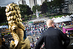 © Joel Goodman - 07973 332324 . 31 August 2013 . Rochdale , UK . Man and a golden lion enjoy the view from the balcony as the Rock Choir perform below . The Rochdale Feel Good Festival . Photo credit : Joel Goodman