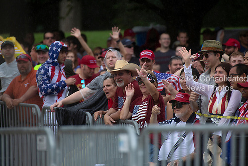 Crowds gather in the rain for United States President Donald J. Trump remarks at his Salute to America event in Washington D.C. on July 4, 2019.  The event has been criticized as politicizing a traditionally non-political holiday.<br /> <br /> Credit: Stefani Reynolds / CNP