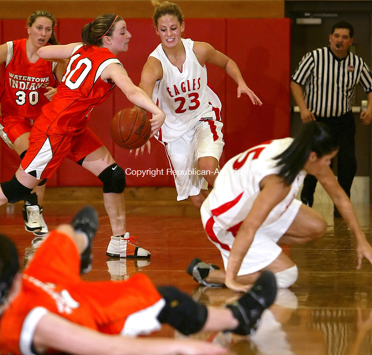 WOLCOTT, CT, 01/13/08- 011309BZ04-  Watertown's Kelly Blake (10) tries to keep control of the ball as Wolcott's (23) Carly Murphy goes for the steal in overtime Tuesday night.<br />  Jamison C. Bazinet Republican-American