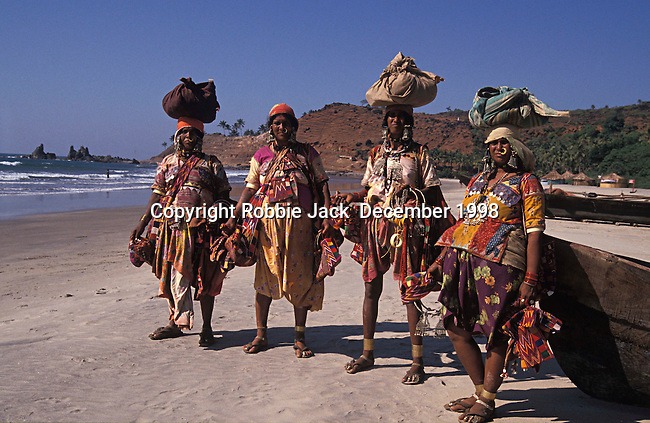 Tribal women possibly from Karnataka on the beach at Vagator in Goa in India.