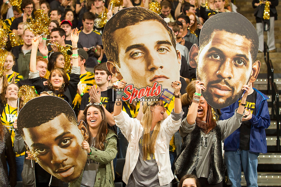 Wake Forest fans hold up giant heads of (L-R) Codi Miller-McIntyre , Chase Fischer and C.J. Harris prior to the game against the Duke Blue Devils at the LJVM Coliseum on January 30, 2013 in Winston-Salem, North Carolina.  The Blue Devils defeated the Demon Deacons 75-70.  (Brian Westerholt/Sports On Film)