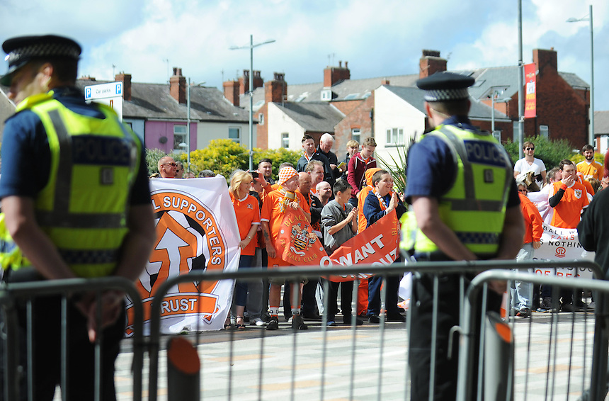 Police officers stand by as Blackpool fans stage a protest against the club's owners before todays match<br /> <br /> Photographer Kevin Barnes/CameraSport<br /> <br /> Football - The Football League Sky Bet League One - Blackpool v Rochdale - Saturday 15th August 2015 - Bloomfield Road - Blackpool<br /> <br /> &copy; CameraSport - 43 Linden Ave. Countesthorpe. Leicester. England. LE8 5PG - Tel: +44 (0) 116 277 4147 - admin@camerasport.com - www.camerasport.com