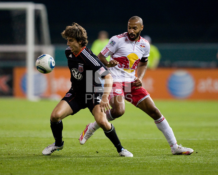 Dejan Jakovic (5) of D.C. United fights for the ball with Thierry Henry (14) of the New York Red Bulls during the game at RFK Stadium in Washington, DC.  D.C. United lost to the New York Red Bulls, 4-0.