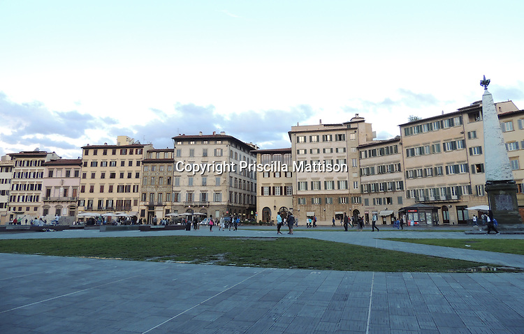 Florence, Italy - October 1, 2012:  Afternoon light fades over the Piazza Santa Maria Novella.