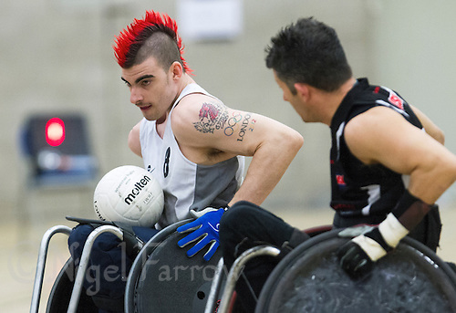 27 MAY 2013 - DONCASTER, GBR - David Anthony (left) of the South Wales Pirates attempts to avoid a challenge from Alan Ash of the West Coast Crash during their 2013 Great Britain Wheelchair Rugby Nationals bronze medal match at The Dome in Doncaster, South Yorkshire, Great Britain (PHOTO (C) 2013 NIGEL FARROW)