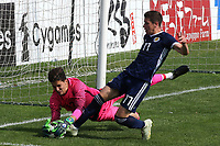 Turkey goalkeeper, Altay Bayindir, dives at the feet of Scotland U21's Harvey St Clair during Turkey Under-21 vs Scotland Under-21, Tournoi Maurice Revello Football at Stade Francis Turcan on 9th June 2018