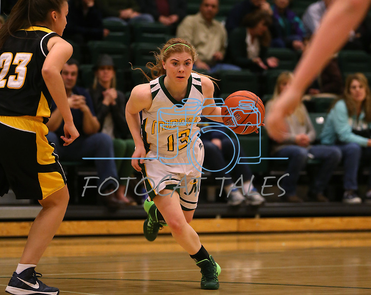 Manogue's Tawni Henderson drives the ball against Galena at Manogue High School in Reno, Nev., on Tuesday, Feb. 11, 2014. Manogue won 51-29.<br /> Photo by Cathleen Allison
