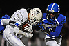 Mepham running back No. 33 Dylon Parzych, left, fights for yards as Long Beach No. 1 Norman Wilson closes in on him during a Nassau County Conference II varsity football game played at Long Beach Middle School on Friday, October 16, 2015. Mepham led 14-0 at halftime.<br /> <br /> James Escher