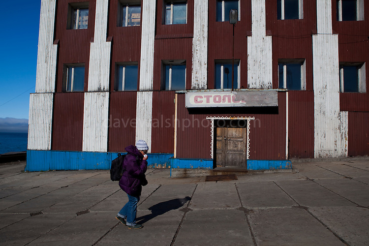 A tourist passed the closed down Cafe-Bar 78 Parallel in Barentsburg, a Russian coal mining town in the Norwegian Archipelego of Svalbard. Once home to about 2000 miners and their families, less than 500 people now live here.