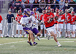 UAlbany Men's Lacrosse defeats Stony Brook on March 31 at Casey Stadium.  Mike McCannell (#92) defended by Kyle McClancy (#40).