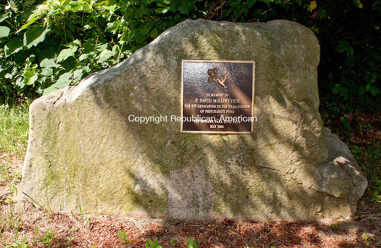 WATERBURY- JULY 10 2014 070914DA07- A memorial stone stands at Pritchard's Pond in Waterbury in memory of F. David Miklinevich for his dedication to the preservation of the pond in 2006.<br /> Darlene Douty Republican American