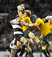 """Twickenham, GREAT BRITAIN, James O""""CONNER, looking to off load the ball after being wrapped up by Victor MATFIELD, during the 2011 Killik Cup Match Barbarians [Baa Baa's] vs Australia, Played at the RFU Stadium Twickenham, Surrey on Saturday 26/11/2011 [Photo, Peter Spurrier/Intersport-images]"""