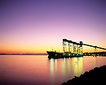 Sunset over Elliot Bay with a tanker moored at the Grain Terminal at the Port of Seattle, Washington State USA