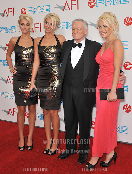 Hugh Hefner with Karissa Shannon, Kristina Shannon & Crystal Harris at the 37th AFI Life Achievement Award Gala at Sony Studios, Los Angeles, where Michael Douglas was honored with the AFI's Life Achievement Award..The show will air in the US on TV Land Prime on July 19th..June 11, 2009  Los Angeles, CA.Picture: Paul Smith / Featureflash