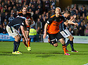 Dundee Utd's Jaroslaw Fojut celebrates after he scores United's late winner..