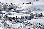 A Winter frosted fence of a rustic Colorado ranch in the Flat Tops Wilderness.