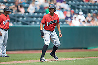 Christopher Bostick (7) of the Indianapolis Indians takes his lead off of third base against the Columbus Clippers at Huntington Park on June 17, 2018 in Columbus, Ohio. The Indians defeated the Clippers 6-3.  (Brian Westerholt/Four Seam Images)