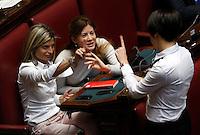 Da sinistra, le deputate Laura Ravetto, Gabriella Giammanco e Nunzia De Girolamo vestite di bianco per sottolineare il sostegno all'emendamento che prevede le quote rosa nel disegno di legge della riforma del sistema elettorale, durante la discussione alla Camera dei Deputati, Roma, 10 marzo 2014.<br /> From left, lawmakers Laura Ravetto, Gabriella Giammanco and Nunzia De Girolamo wearing in white to mark their support to the amendment on gender parity in the new electoral law, during the discussion at the Lower Chamber in Rome, 10 March 2014.<br /> UPDATE IMAGES PRESS/Riccardo De Luca