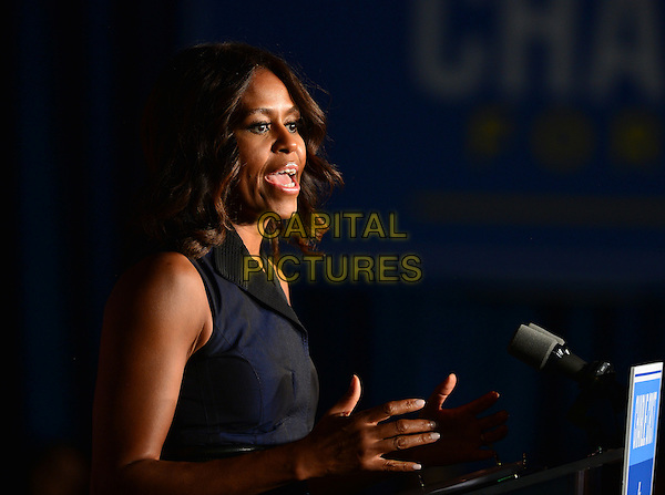 MIAMI GARDENS, FL - OCTOBER 17: First Lady Michelle Obama speaks as she campaigns for former Florida Governor and now Democratic gubernatorial candidate Charlie Crist during an event at the Betty T. Ferguson Recreational Complex Gymnasium on October 17, 2014 in Miami Gardens, Florida. Crist is facing off against incumbent Republican Governor Rick Scott in the November 4, 2014 election  <br /> CAP/MPI10<br /> &copy;mpi10/MediaPunch/Capital Pictures