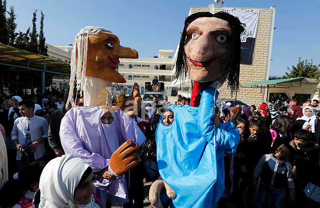 Palestinian students at a United Nations-run school celebrate during street carnival in the West Bank village of Halhoul near Hebron on November 19, 2018. Photo by Wisam Hashlamoun
