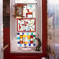 The window in the first-floor bathroom is made of stained glass designed by Lord Snowdon