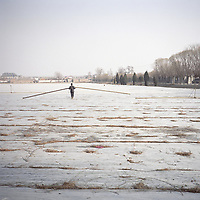 A Chinese farmer works in the field in the countryside of Beijing, China, January 2011.
