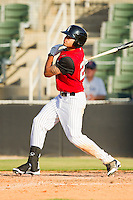 Keenyn Walker #23 of the Kannapolis Intimidators follows through on his swing against the Hickory Crawdads at CMC-Northeast Stadium on April 8, 2012 in Kannapolis, North Carolina.  The Intimidators defeated the Crawdads 12-11.  (Brian Westerholt/Four Seam Images)
