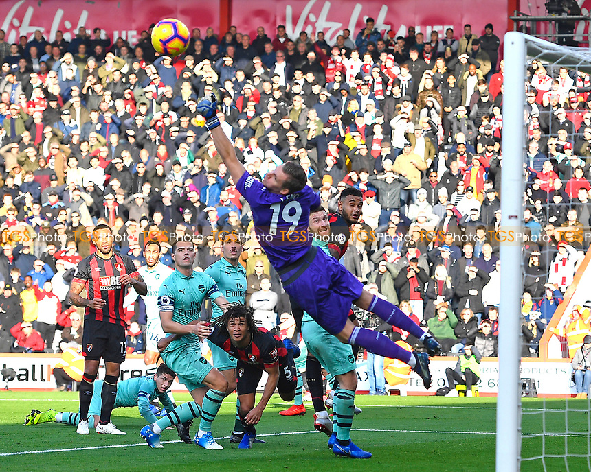 Bernd Leno of Arsenal makes a save from a Joshua King  header during AFC Bournemouth vs Arsenal, Premier League Football at the Vitality Stadium on 25th November 2018