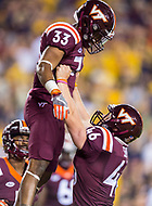 Landover, MD - SEPT 3, 2017: Virginia Tech Hokies running back Deshawn McClease (33) is picked up in celebration by Virginia Tech Hokies place kicker Joey Slye (46) after his late touchdown during game between West Virginia and Virginia Tech at FedEx Field in Landover, MD. (Photo by Phil Peters/Media Images International)