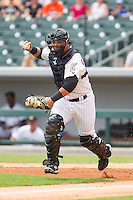 Charlotte Knights catcher Miguel Gonzalez (23) chases a runner back towards third base during the game against the Pawtucket Red Sox at BB&T Ballpark on August 8, 2014 in Charlotte, North Carolina.  The Red Sox defeated the Knights  11-8.  (Brian Westerholt/Four Seam Images)
