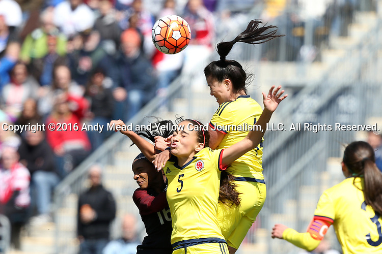 10 April 2016: Isabella Echeverri (COL) (5) challenges for a header against Nataly Arias (COL) (right) and Crystal Dunn (USA) (left). The United States Women's National Team played the Colombia Women's National Team at Talen Energy Stadium in Chester, Pennsylvania in an women's international friendly soccer game. The U.S. won the match 3-0.