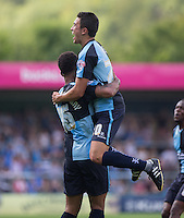 Luke O'Nien of Wycombe Wanderers jumps to celebrate with goal scorer Aaron Amadi Holloway of Wycombe Wanderers during the Sky Bet League 2 match between Wycombe Wanderers and York City at Adams Park, High Wycombe, England on 8 August 2015. Photo by Andy Rowland.