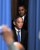 Washington, D.C. - February 5, 2009 -- United States President Barack Obama, center top, and United States Secretary of Energy Dr. Steven Chu, center bottom, arrive at the United States Department of Energy to make remarks to employees in Washington, D.C. on Thursday, February 5, 2009..Credit: Ron Sachs / Pool via CNP