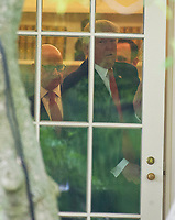 United States President Donald J. Trump, followed by US National Security Advisor H. R. McMaster, prepares to open the door to depart the Oval Office of the White House in Washington, DC for a trip to Miami, Florida on Friday, June 16, 2017.  In Miami, the President will give remarks and participate in a signing on the United Statesí policy towards Cuba. Photo Credit: Ron Sachs/CNP/AdMedia