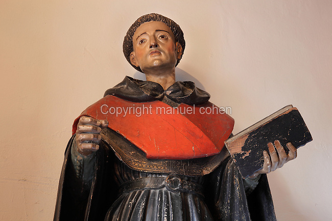 Statue of San Juan de Sahagun, 1419-79, Augustinian friar, priest and saint, in wood, in the Monasterio de San Jeronimo, or Monastery of St Jerome, 16th century Roman Catholic church and Hieronymite monastery founded by the Catholic monarchs in Santa Fe, Granada, Andalusia, Southern Spain. Granada was listed as a UNESCO World Heritage Site in 1984. Picture by Manuel Cohen