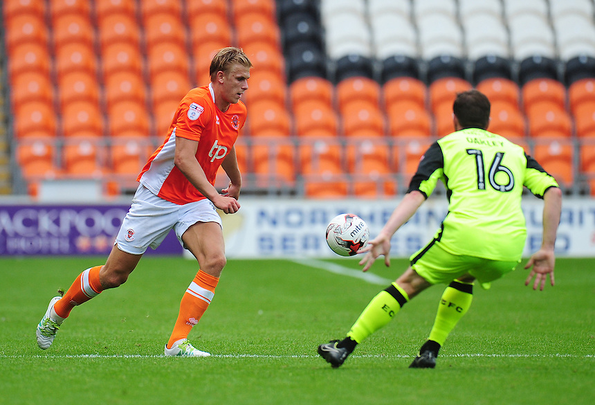 Blackpool's Brad Potts under pressure from Exeter City's Matt Oakley<br /> <br /> Photographer Kevin Barnes/CameraSport<br /> <br /> Football - The EFL Sky Bet League Two - Blackpool v Exeter City - Saturday 6th August 2016 - Bloomfield Road - Blackpool<br /> <br /> World Copyright &copy; 2016 CameraSport. All rights reserved. 43 Linden Ave. Countesthorpe. Leicester. England. LE8 5PG - Tel: +44 (0) 116 277 4147 - admin@camerasport.com - www.camerasport.com