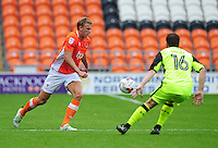 Blackpool's Brad Potts under pressure from Exeter City's Matt Oakley<br /> <br /> Photographer Kevin Barnes/CameraSport<br /> <br /> Football - The EFL Sky Bet League Two - Blackpool v Exeter City - Saturday 6th August 2016 - Bloomfield Road - Blackpool<br /> <br /> World Copyright © 2016 CameraSport. All rights reserved. 43 Linden Ave. Countesthorpe. Leicester. England. LE8 5PG - Tel: +44 (0) 116 277 4147 - admin@camerasport.com - www.camerasport.com