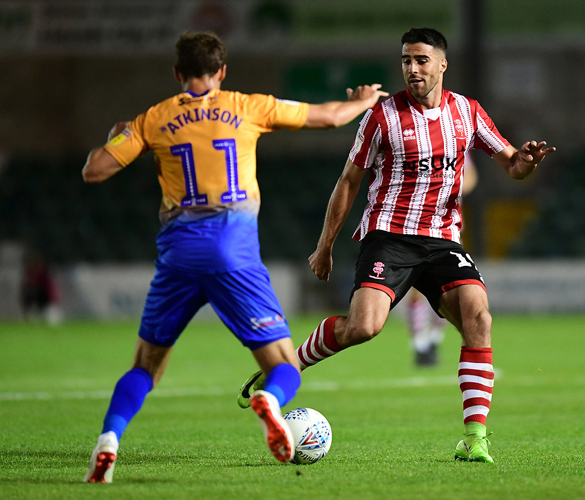 Lincoln City's Joan Luque vies for possession with Mansfield Town's Will Atkinson<br /> <br /> Photographer Chris Vaughan/CameraSport<br /> <br /> The EFL Checkatrade Trophy Group H - Lincoln City v Mansfield Town - Tuesday September 4th 2018 - Sincil Bank - Lincoln<br />  <br /> World Copyright © 2018 CameraSport. All rights reserved. 43 Linden Ave. Countesthorpe. Leicester. England. LE8 5PG - Tel: +44 (0) 116 277 4147 - admin@camerasport.com - www.camerasport.com