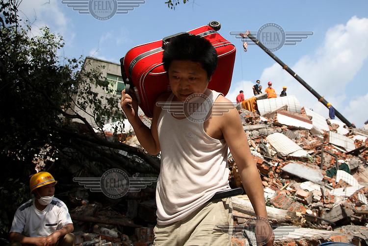 Residents salvage belongings from ruined houses. An earthquake measuring 7.9 on the richter scale hit Sichuan on 12/05/2008.