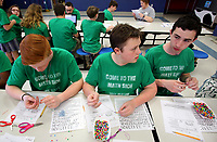 NWA Democrat-Gazette/DAVID GOTTSCHALK Conrad Myers (from left), Andrew Brothers and Gianni Squillace, all eighth grade students at St. Vincent de Paul Catholic School, make Wednesday, March 14, 2018, Pi Day Bracelets as they participate in Pi Day activities at the school in Rogers. Seventh and eighth grade students participated in five activities that featured the bracelet making, writing of Pi-Kus, and pie eating.