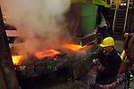 A worker took time for a quick smoke as he oversaw a line of copper plates in the smelting section of the copper factory of the company Norilsk Nickel in the city of Norilsk, a vital metallurgical industrial city in Russia's Artic north. June 15, 2007
